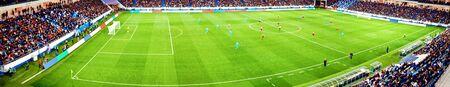 Football stadium, shiny lights, view from field. Soccer concept Фото со стока