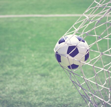 Traditional soccer game with a leather ball Фото со стока