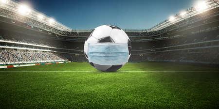 Euro soccer cancellation event concept. Ball with coronavirus mask 版權商用圖片