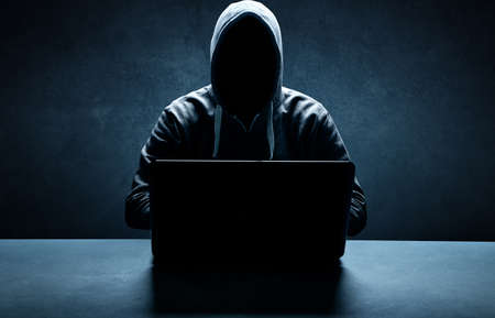 Hacker prints a code on a laptop keyboard to break into a cyberspace