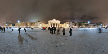 Brandenburg Gate and Pariser Platz in Berlin, Germany  Panorama is made late cloudy January evening  360 degree panoramic composition  Stockfoto