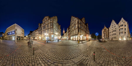 360 degree panoramic composition of old cobblestone section of Hanover, Germany, at twilight