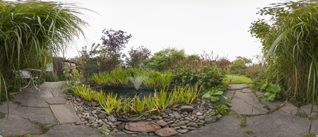 360 degree panorama of a garden with a pond