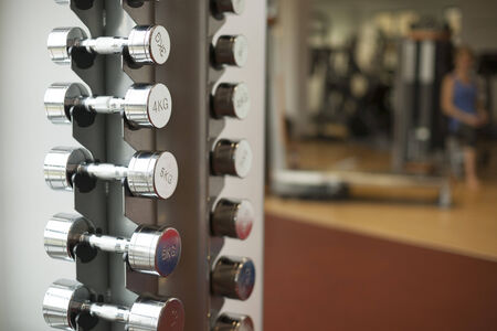 Set of metal dumbbells in fitness studio photo