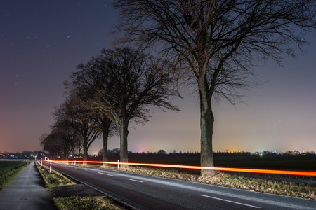 starlit: rural road in the moonless starlit night Stock Photo