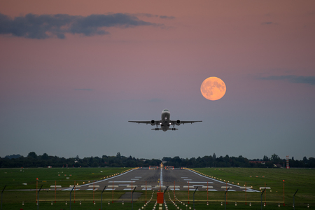 airplane wing: Plane take-off under the full moon in Hannover airport