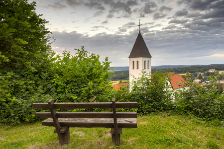 Empty bench at the church in Germany