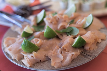 light meal a salmon with a lime on a plate