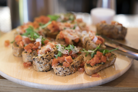 Bruschetta with tomato and cheese on a plate
