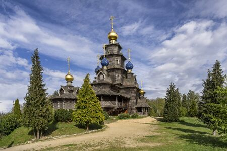 ancient wooden Russian orthodox church ad summer day