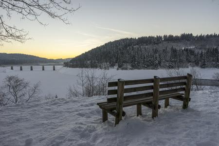 Beautiful winter landscape on Oker Dam in Harz in the frosty evening. Lower Saxony.