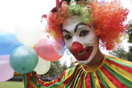 Clown Holding Balloons, Smiling, Portrait LANG_EVOIMAGES