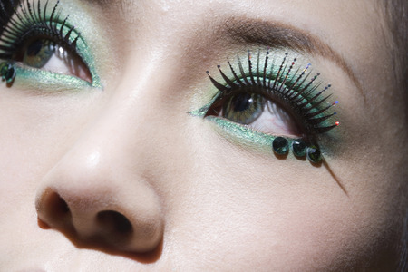 Close-Up Of A Young Woman Wearing False Eyelashes