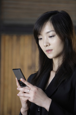 Close-Up Of A Businesswoman Reading Text Message