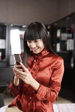 Woman Text Massaging On Mobile Phone, Smiling