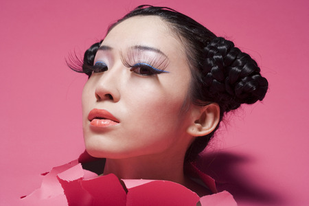 Close-Up Of A Young Woman Wearing Lipstick And Eyelashes LANG_EVOIMAGES