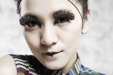 Close-Up Of A Young Woman Wearing False Eyelash