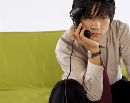 Young Man Holding Joystick LANG_EVOIMAGES