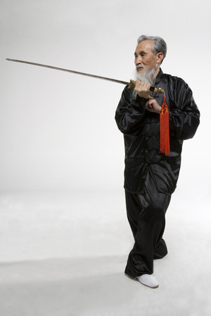 An Old Man Practicing A Chinese Sword