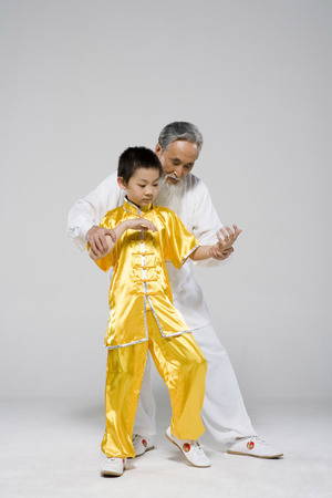 An Old Man Teaching A Boy Taiji