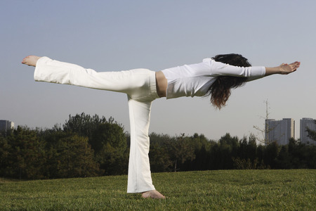 A Chinese Young Woman Doing Yoga