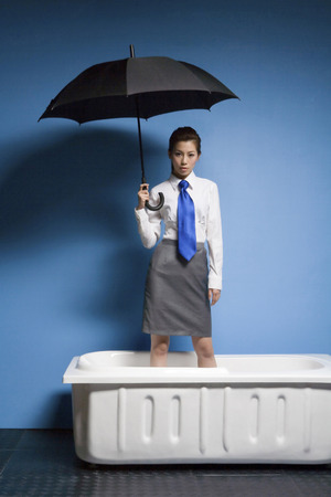 A Business Woman Standing In The Bath And Taking An Umbrella