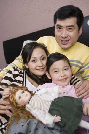 A Family Lying On The Bed