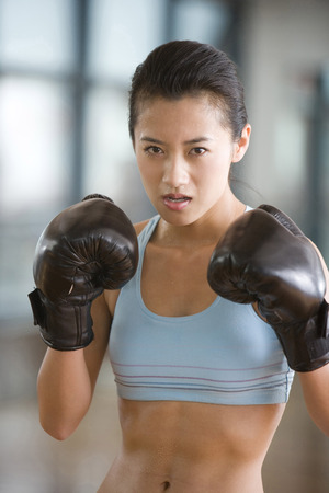 A Woman Doing Fight LANG_EVOIMAGES