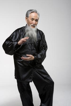 An Old Man Doing Taiji LANG_EVOIMAGES