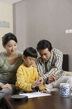 A Family Writing With Chinese Inkbrushes