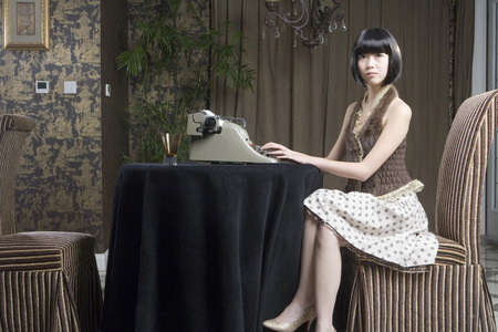 A Fashionable Woman Typing