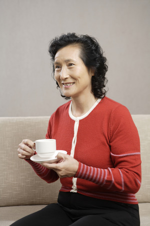 A Middle-Aged Woman Taking Coffee