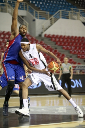 thessaloniki: THESSALONIKI, GREECE - FEBRUARY 25: Ryvon Coville (L) and Rawle Marshall (R) in a basketball match between PAOK and PANIONIOS, on February 25, 2011, Thessaloniki, Greece. Editorial