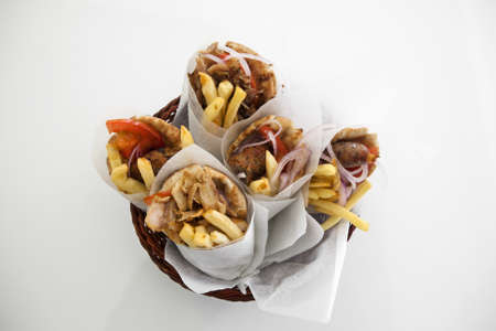 sandwitch: Greek gyros in a plate under studio lights