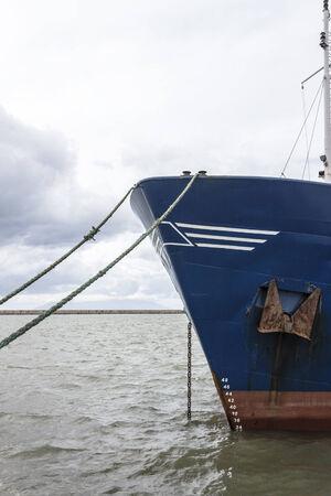 prow: Cargo ship prow in harbor under sunlight Stock Photo