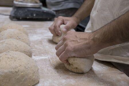 Baker preparing the bread dough