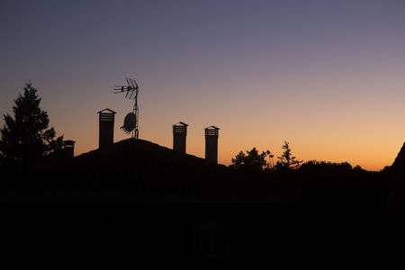 Colorful sunset with a house silhouette Foto de archivo