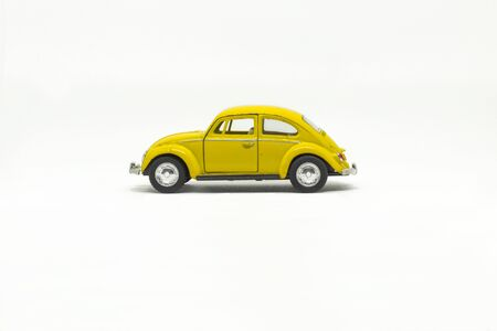 Old yellow toy car