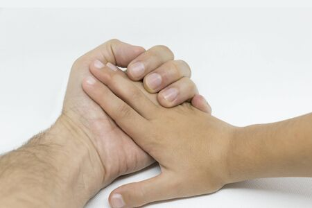 Father's and Son's hands on white Background