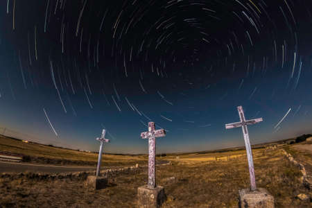 Star trail photo of Las tres Cruces, in San Pedro de Gaillos, Segovia, Spain