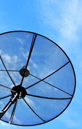 The black satellite dish with blue sky Stock Photo