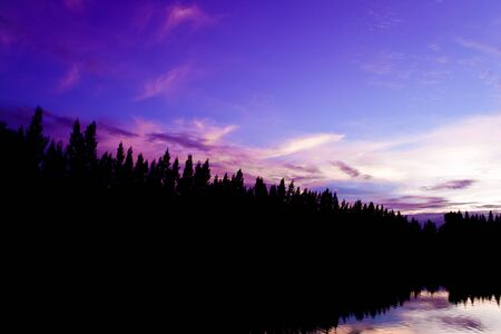 Twilight sky with the reflection on the lake. Stock Photo