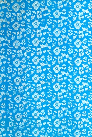 wall painting as white flower pattern on blue background Stock Photo