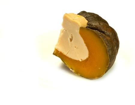 a quater of steam pumpkin filled with sweet custard,one of thai dessert
