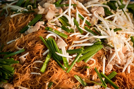 Thai fried noodle with pork and mungbean sprouts photo