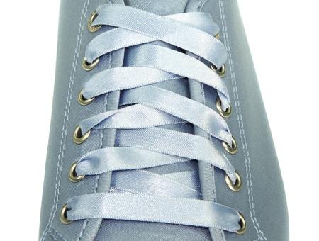 blue ribbon shoe lacing on white background