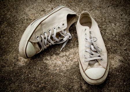 pair of old sneakers on grungy background