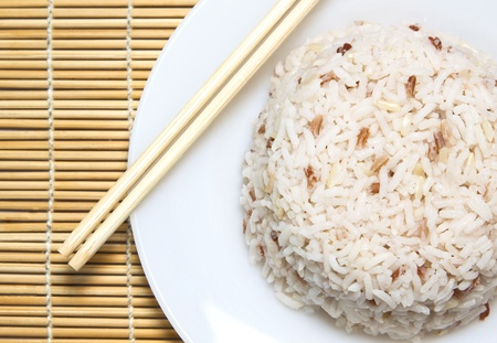 steam jasmine rice with chopstick  which is the traditional asian meal