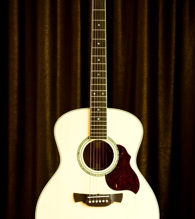 acoustic guitar on brown background