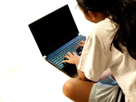 asian girl using notebook computer on white background Stock Photo - 10619132
